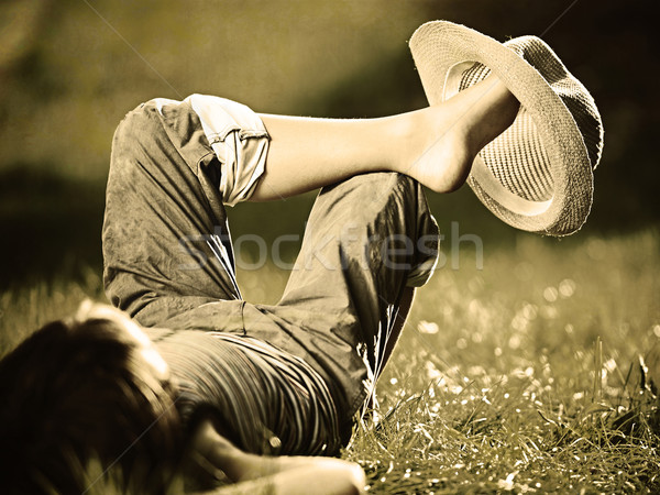 Retro photography of a boy in summertime relaxing on grass Stock photo © zurijeta