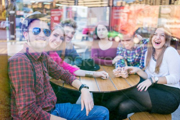 Authentic image of young real people having good time together Stock photo © zurijeta
