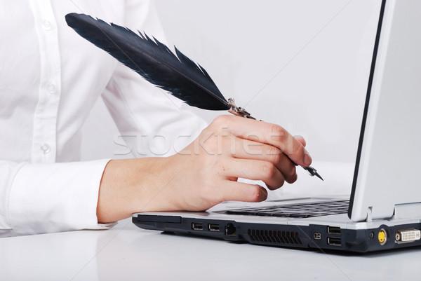 Hand writing with feather on laptop Stock photo © zurijeta