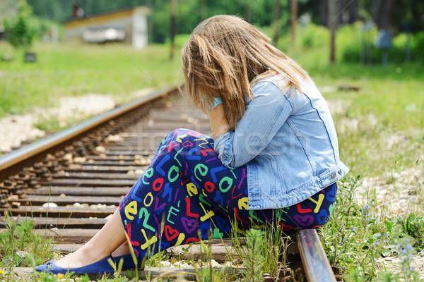 Stock photo: Woman sitting on railway tracks