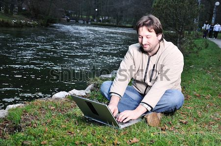 Young man with laptop outdoor  Stock photo © zurijeta