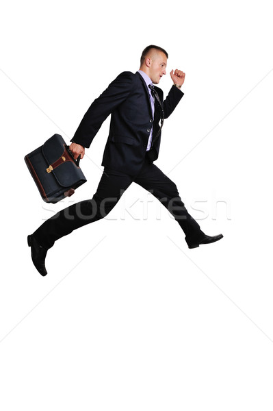 Full body of a businessman witha suitcase in a hurry over white background Stock photo © zurijeta