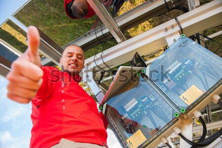 Stock photo: Engineer working with laptop installing  solar panels