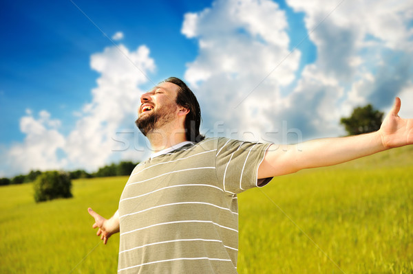 Happy succesful man in nature with wide open arms  Stock photo © zurijeta