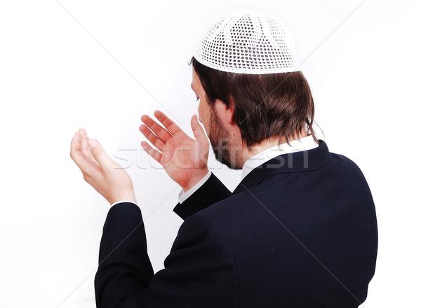 Young male muslim is praying and asking God Stock photo © zurijeta