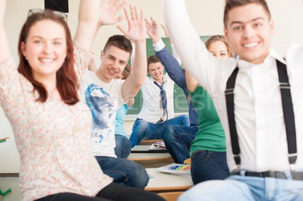 örömteli diákok tart integet karok osztályterem Stock fotó © zurijeta