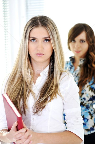 Two girls with one red book Stock photo © zurijeta