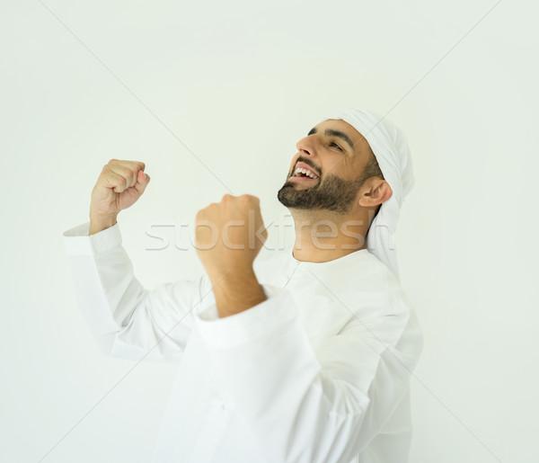 Atrakcyjny arabskie człowiek młody człowiek stwarzające Zdjęcia stock © zurijeta