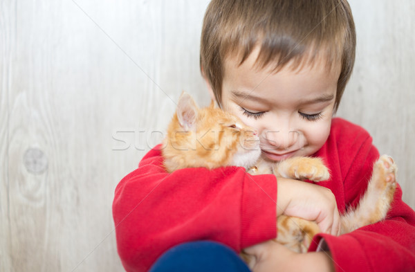 Happy little kid with kitty cat Stock photo © zurijeta