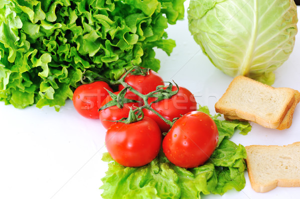 Nutritios meal made of tomatoes, lettuce, salad, cabbage and bread Stock photo © zurijeta