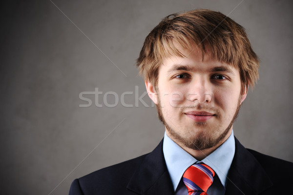 Handsome young man in a suit and west Stock photo © zurijeta