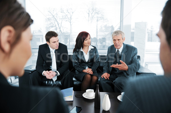 Stock photo: Businsss people  having coffee at office meeting