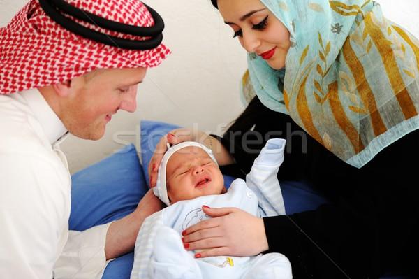 Arabic Muslim couple with new baby at home Stock photo © zurijeta