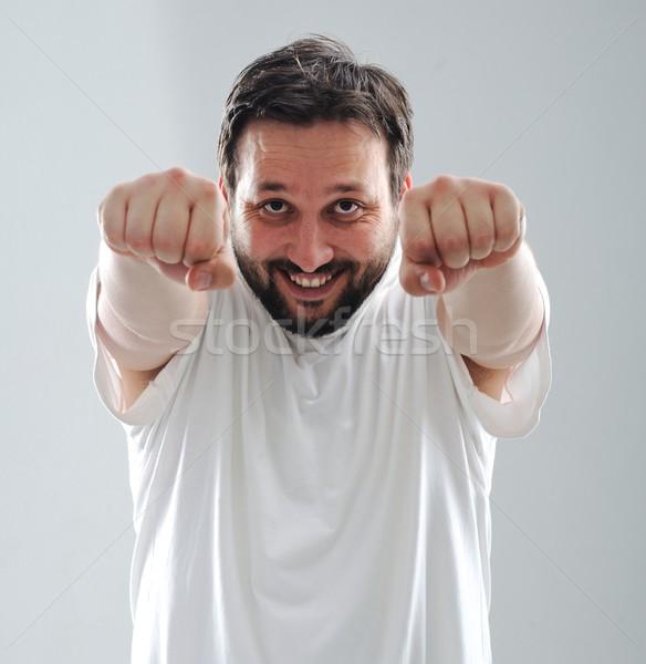 Battenti uomo business sorriso lavoro imprenditore Foto d'archivio © zurijeta
