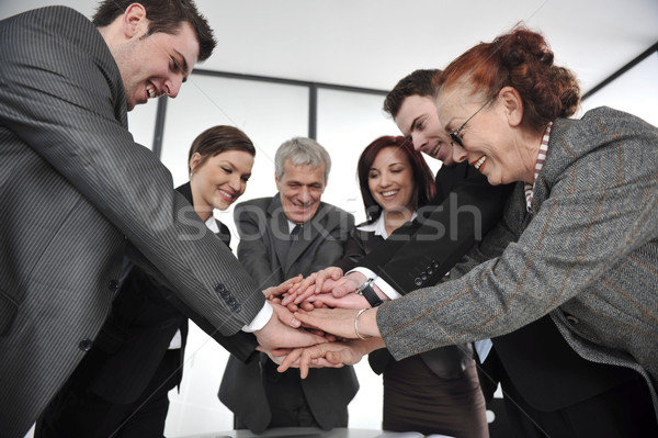 Business partners hands on top of each other symbolizing companionship and unity Stock photo © zurijeta