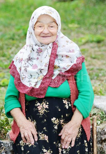 Very aged woman sitting in nature, portrait Stock photo © zurijeta
