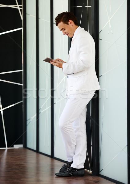молодые бизнесмен Постоянный современных служба лобби Сток-фото © zurijeta