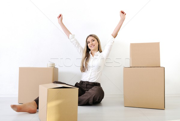 A young teen woman with heands up luggage and belongings moving  Stock photo © zurijeta