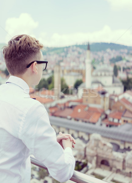 Young businessman with overview on city Stock photo © zurijeta
