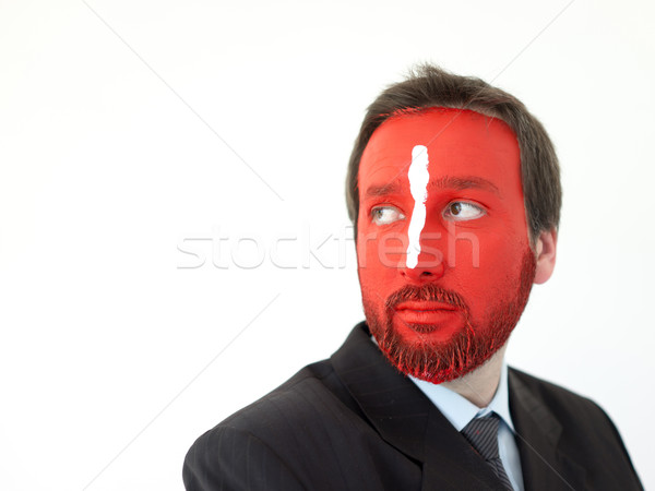 Painted man with red face and white line on nose Stock photo © zurijeta