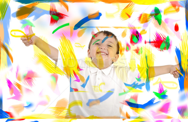 Happy child with thumbs up in colors, space, room Stock photo © zurijeta