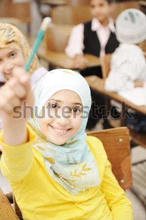Adorable Muslim girl in classroom with her friends children students Stock photo © zurijeta
