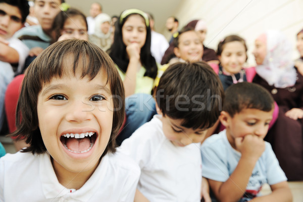Crowd of children, different ages and races in front of the school, breaktime Stock photo © zurijeta
