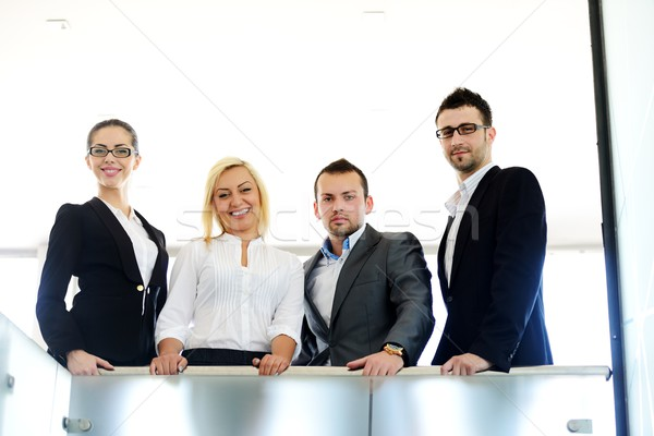 Successful business people standing on railing Stock photo © zurijeta