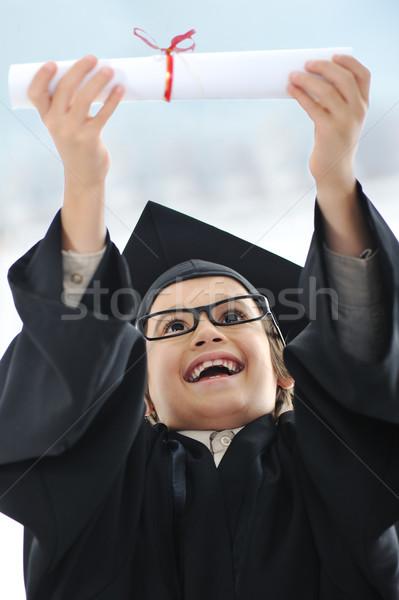 çocuk diploma gözlük erkek mezuniyet Stok fotoğraf © zurijeta