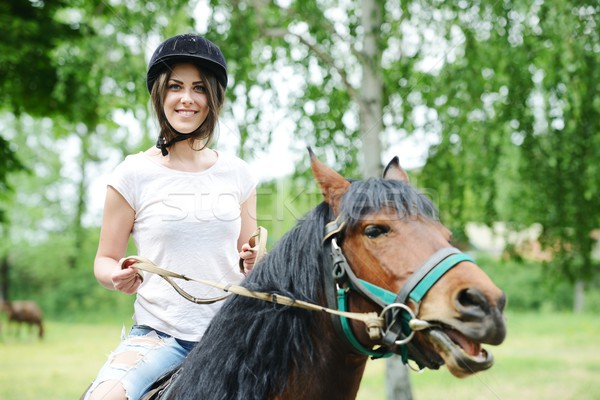 Obraz szczęśliwy kobiet posiedzenia konia w. Zdjęcia stock © zurijeta