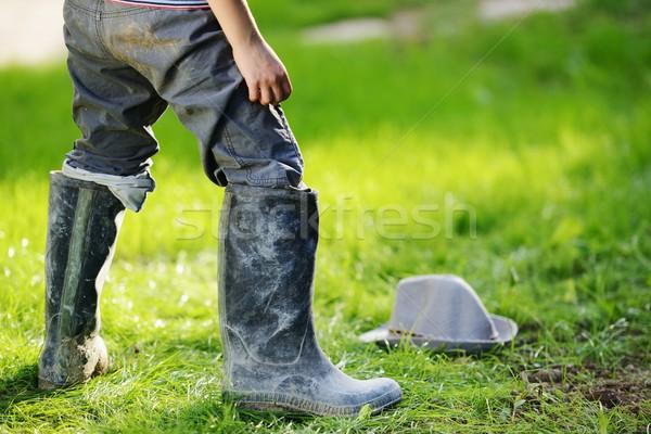Kid wearing big boots Stock photo © zurijeta