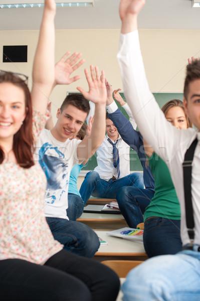 Csoport derűs diákok karok levegő ül Stock fotó © zurijeta