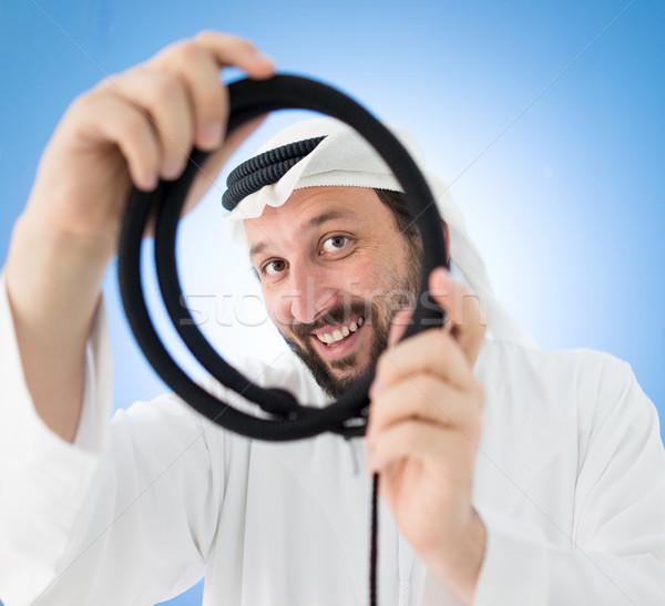 Arab férfi hagyományos ruházat fejkendő kerék Stock fotó © zurijeta