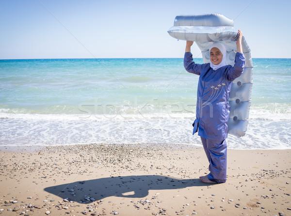 Happy Muslim girl, on summer vacation with swimming suit Stock photo © zurijeta