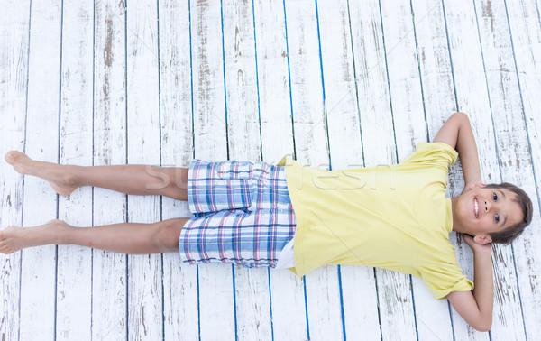 Child on white wooden background Stock photo © zurijeta