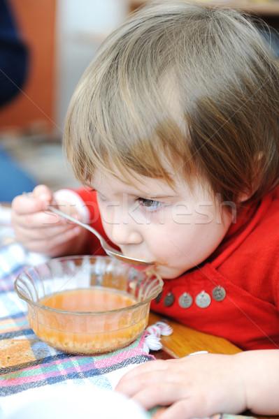 Cute meisje eten hand haren engel Stockfoto © zurijeta