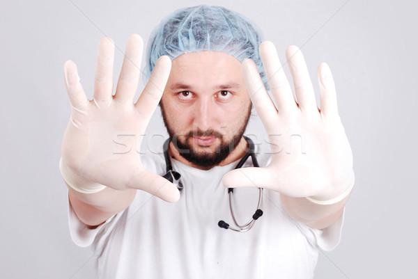 Genç erkek doktor beyaz eller adam çalışmak Stok fotoğraf © zurijeta