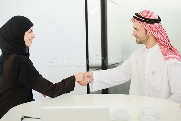 Group of multi ethnic business people dealing a contract and hand shaking Stock photo © zurijeta