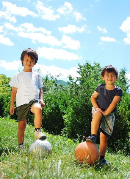 Twee weinig kinderen basketbal voetbal wolken Stockfoto © zurijeta