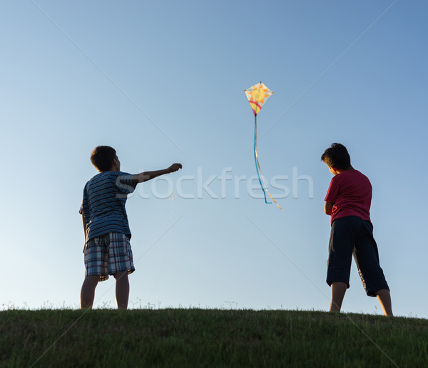 Running with kite silhouette Stock photo © zurijeta