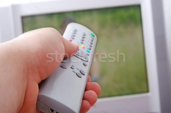 Controle remoto mão televisão usado adulto homem Foto stock © zurijeta