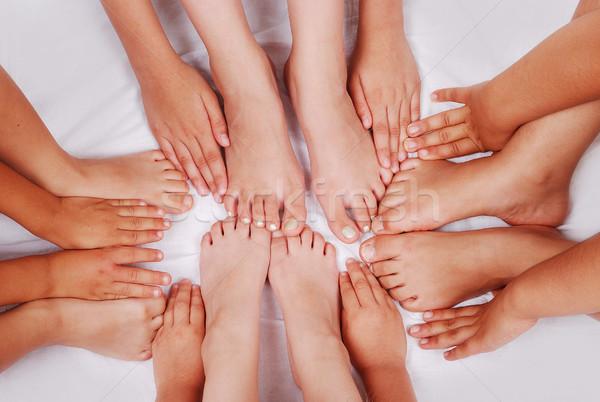 Group of several pairs of children hands and legs Stock photo © zurijeta