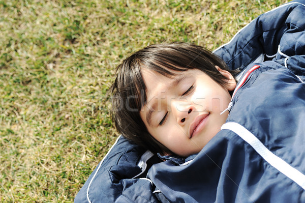 Happy dreaming child on green meadow Stock photo © zurijeta
