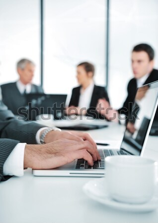 Business ambience, working on laptop during the meeting Stock photo © zurijeta