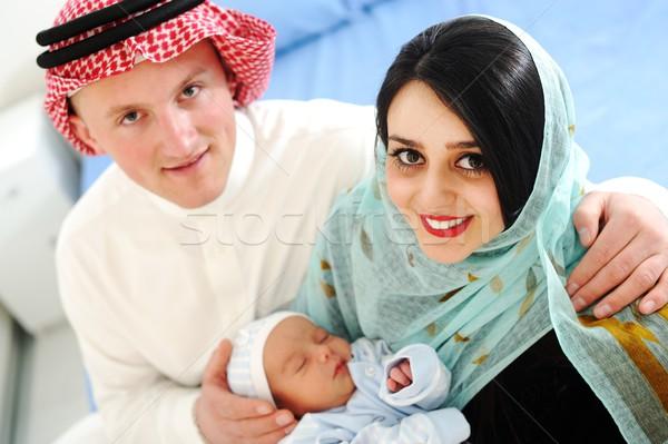 Arab muszlim pár új baba otthon Stock fotó © zurijeta