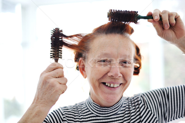 Senior lady hairdressing with many combs Stock photo © zurijeta