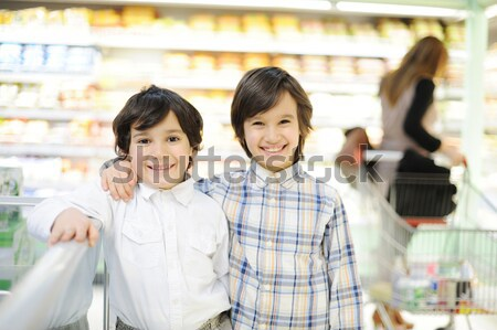Two brothers in shopping mall Stock photo © zurijeta