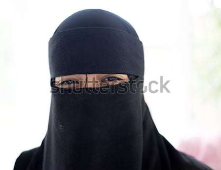 Arabic Muslim girl with veil on face Stock photo © zurijeta
