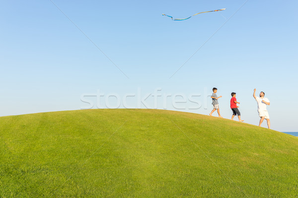 Stock photo: Running with kite on summer holiday vacation, perfect meadow and