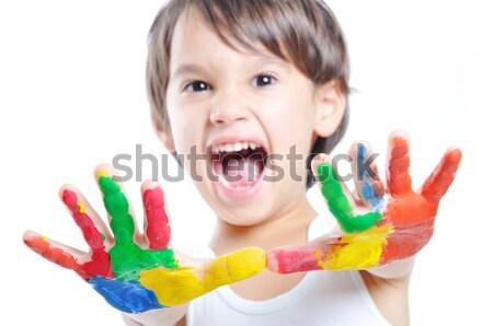 Happy kid with paints on hands Stock photo © zurijeta